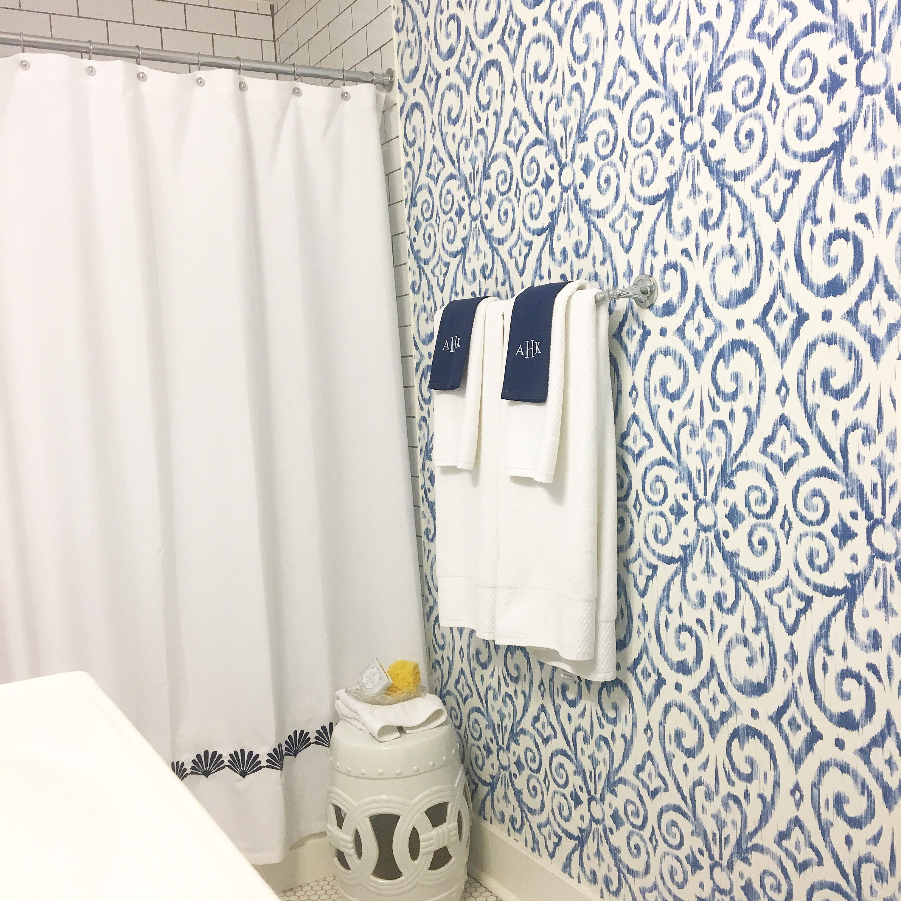 blue and white bathroom with Ikat print wallpaper by Thibaut ...