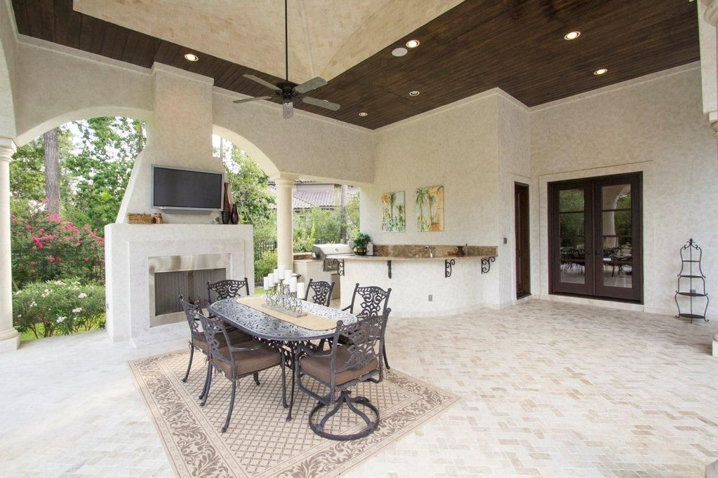The residence also features kitchen outdoors.  #Homes #Backyard #Kitchen #Table