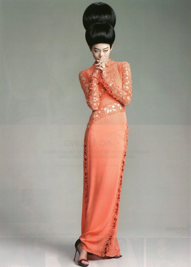 Ermanno Scervino coral crèpe de chine dress with macramè embroideries is a harmonious encounter from distant lands.
