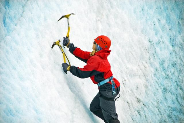 Learn to Ice Climb by Practicing Essential Techniques: Practice swinging your ice tools at the bottom of the icefall to get comfortable with the motion.