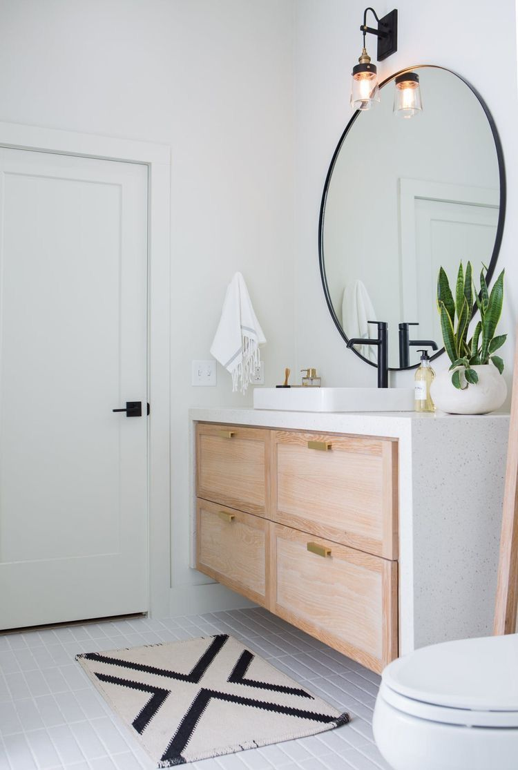 Big round mirror in bathroom with white oak vanity and - Round mirror over bathroom vanity ...