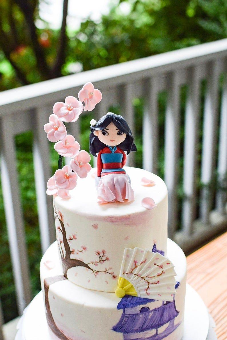 Disney mulaninspired fondant cake topper with fan in 2020