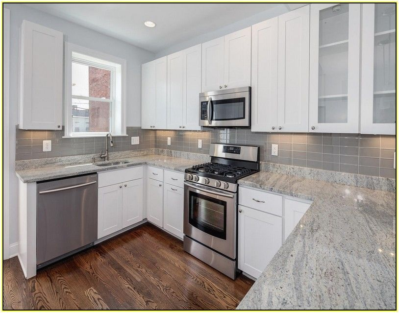 Beau White Kitchen Cabinets With Gray Granite Countertops