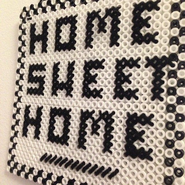 """""""Home Sweet Home"""" - Hama perler bead sign hand-stitched with embroidery by Elinore Fröding"""