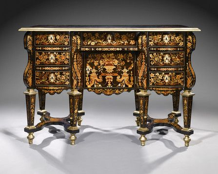 This exquisite floral marquetry kneehole desk or embureau