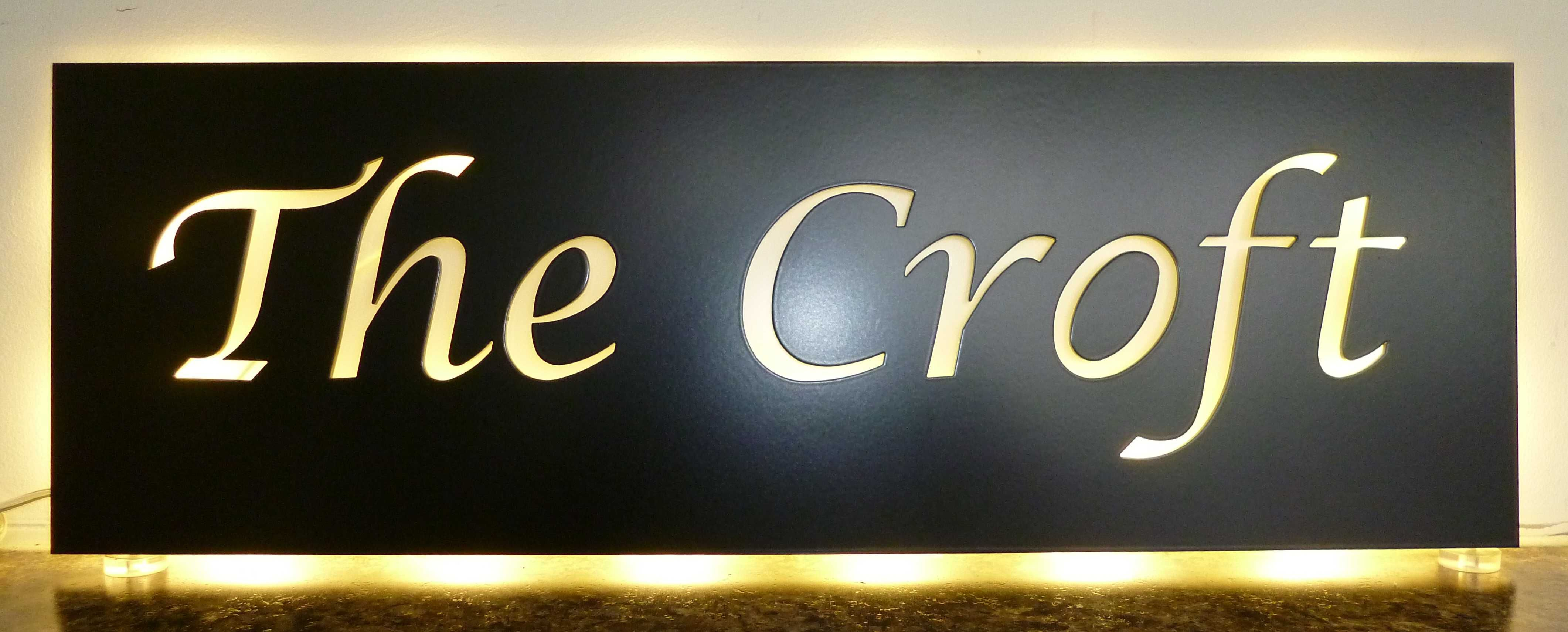 Stainless steel illuminated house name plate with warm white leds from housenumbers limited bespoke design