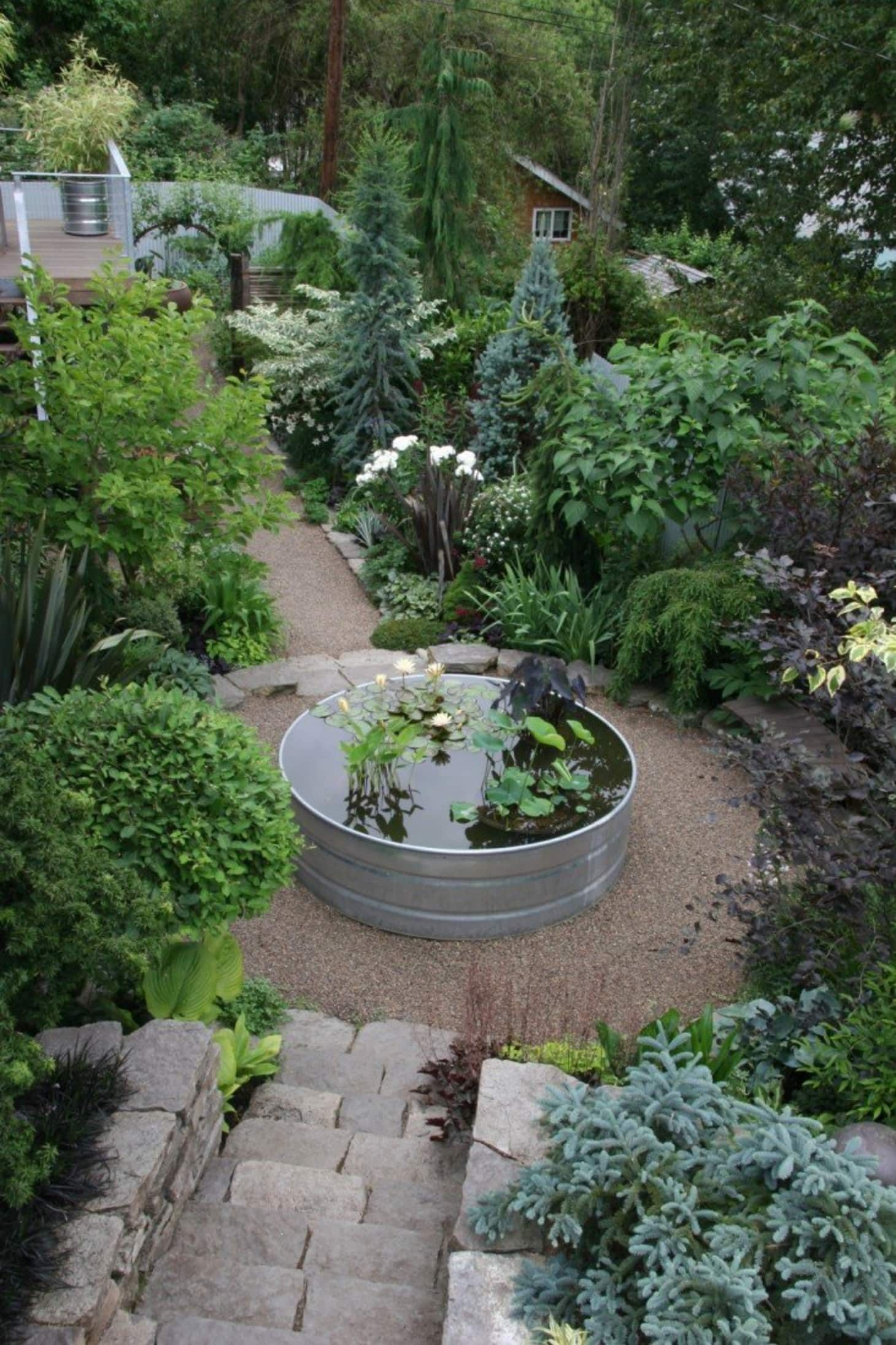 Very Cool Ways to Hack Galvanized Stock Tanks & Troughs is part of Water features in the garden, Mosaic garden, Cottage garden, Garden makeover, Outdoor gardens, Dream garden - Galvanized stock tanks and troughs are essentially huge tubs which can be turned into or reused as any number of things  Depending on the context, they can read modern, industrial, or farmhouse  Learn all the ways you can hack them and create something spectacular and useful for your home  Bathroom Tubs Jayme used a large round tank as a bathtub in her in warm and inviting modernist home in Philadelphia