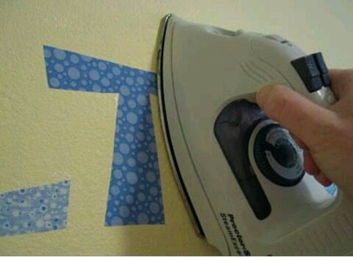 You know you can iron fabric on walls? Never knew that! And it peels right off :))