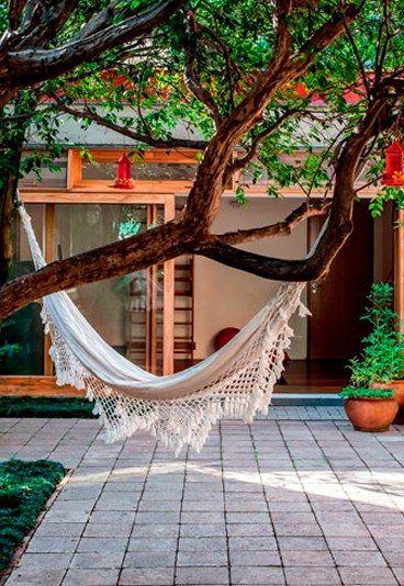 13 ideas para darle vida a tu patio interior decoracion for Jardines traseros