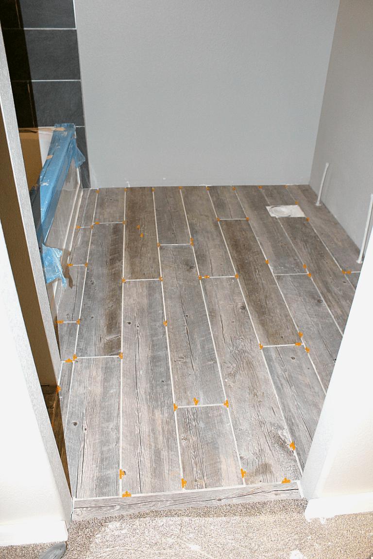 How To Tile A Bathroom Floor With Plank Tiles Plank Tiles Bathroom Flooring Wood Like Tile