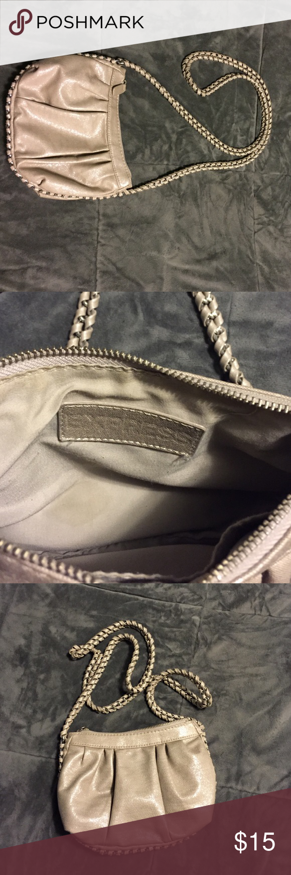 EXPRESS cross-body purse This adorable purse can be worn as a cross-body or shoulder bag. Chain link through the strap . It's a greyish tan with a shimmer. Small stain on the inside ( second picture) Express Bags Crossbody Bags
