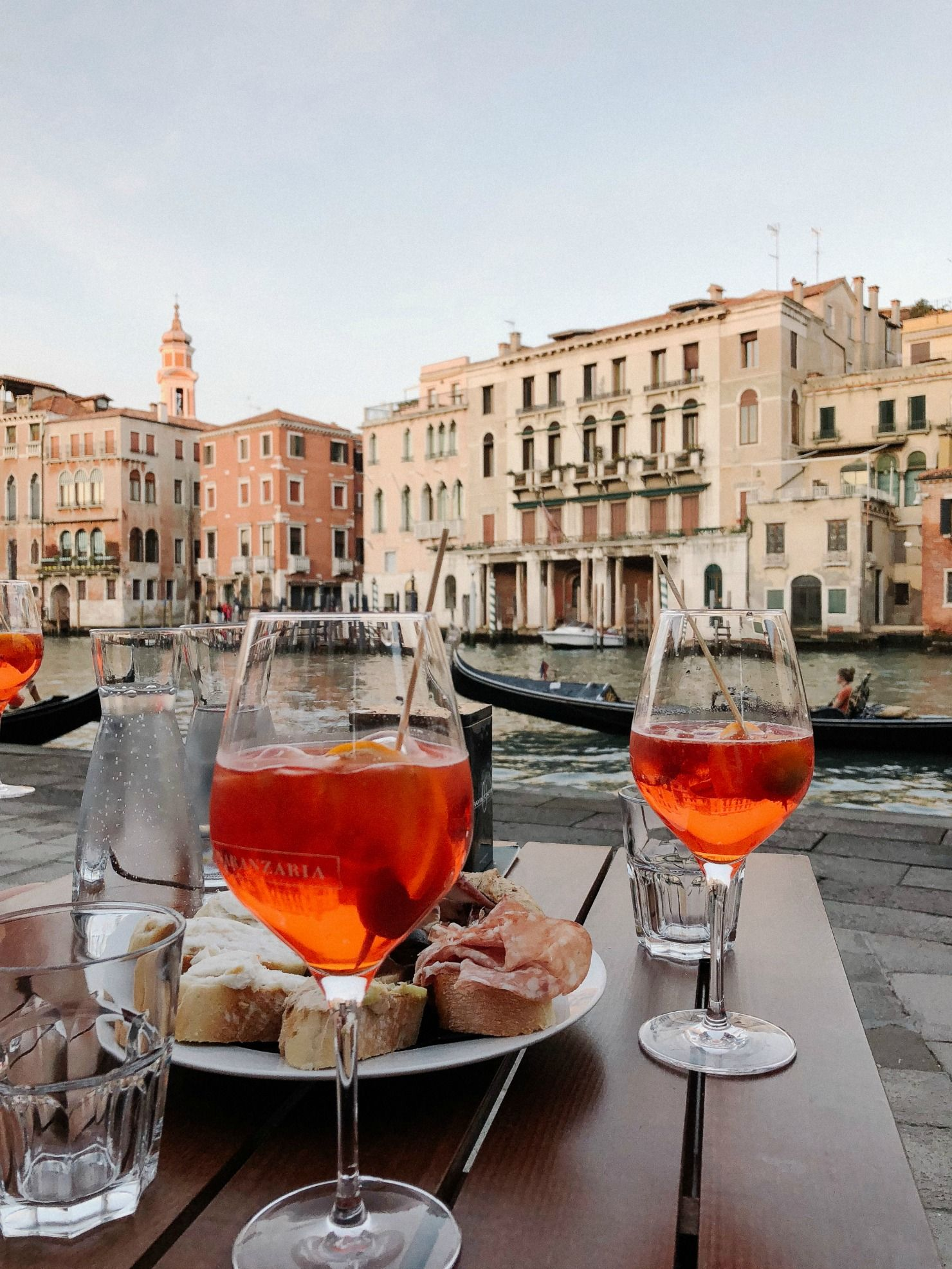 Aperol Spritz and cicchetti on the banks of the Grand Canal in Venice |  Venice italy food, Venice italy travel, Italy food