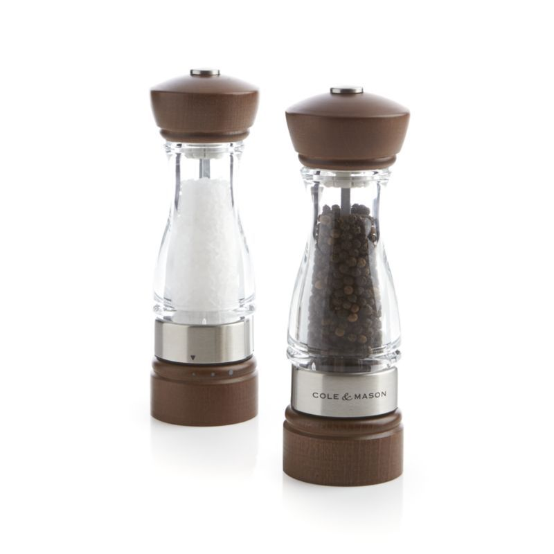 Cole & Mason's premium spring-loaded mills grind with consistent results every time.  Easy-fill wood, stainless and acrylic mills with pre-set coarseness settings provide more salt and pepper per twist than most mills on the market. Dark-stained beechwood top and bottomAcrylic and stainless-steel bodySalt mill has ceramic grinding mechanismPepper mill has carbon steel grinding mechanismSalt mill includes 3. 32 oz.  of whole salt from BelgiumPepper mill includes 1. 48 oz.
