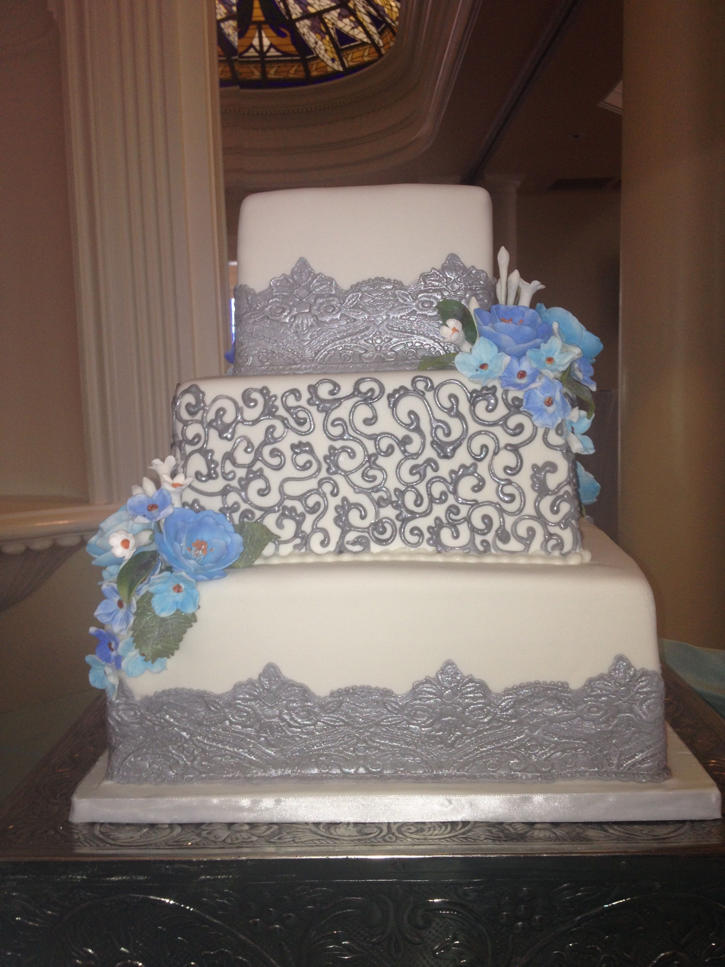 wedding bakeries in sacramento ca%0A Silver and blue wedding cake  Blue and white sugar flowers and lace three  tier wedding