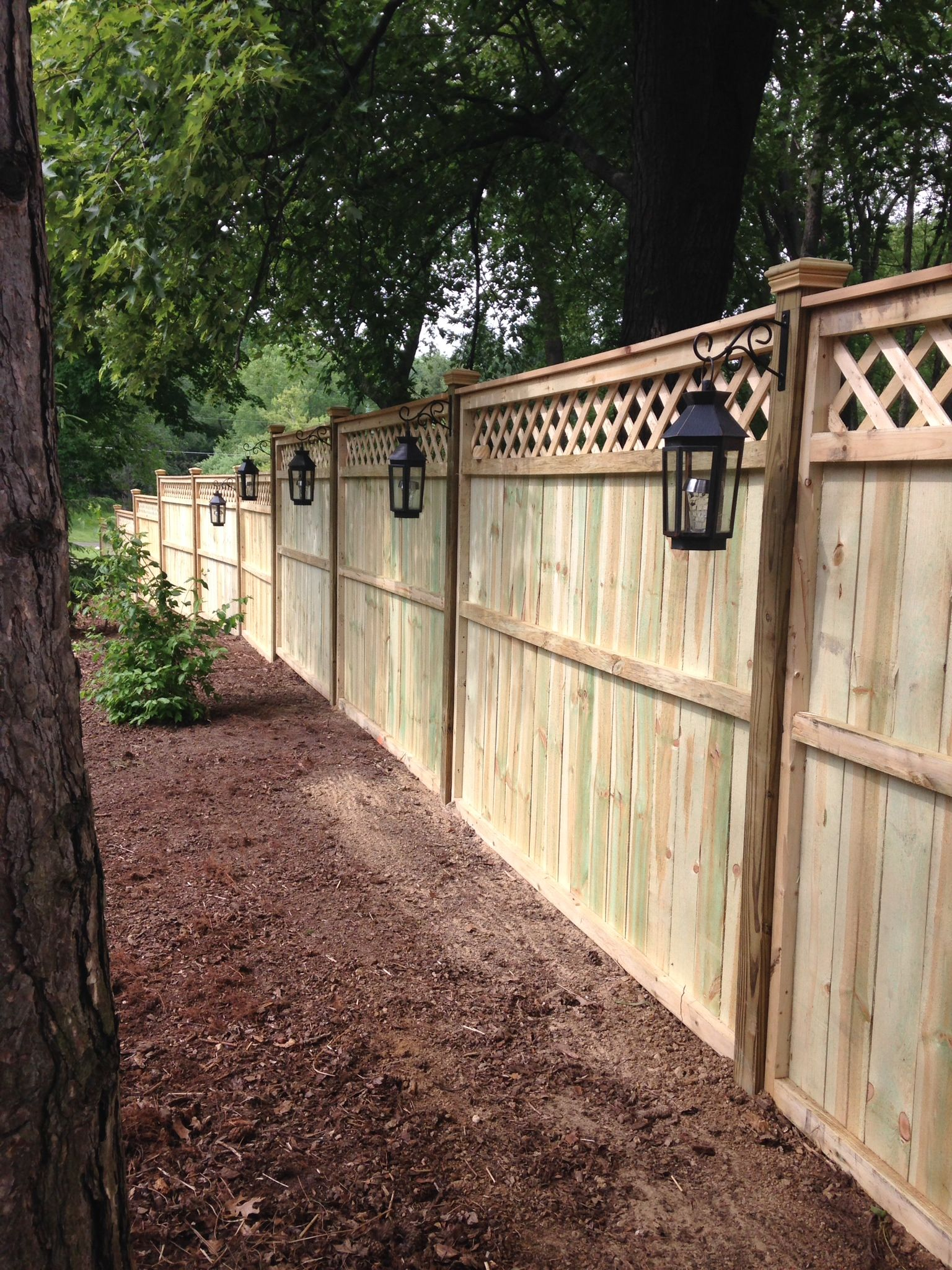 Privacy fence with lanterns. Outdoor fence decor, Fence