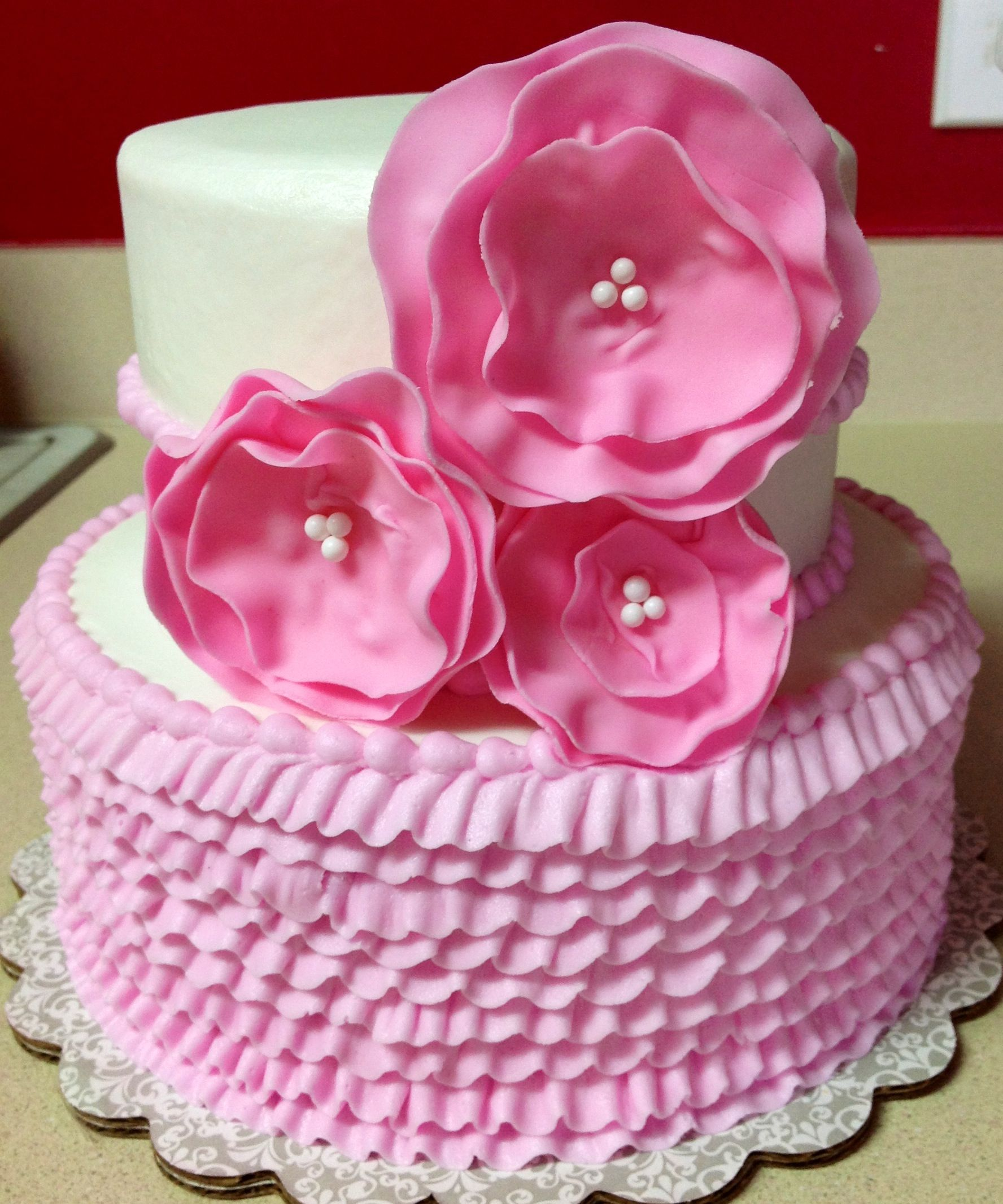 Little girl birthday cake Buttercream with fondant flowers Slice