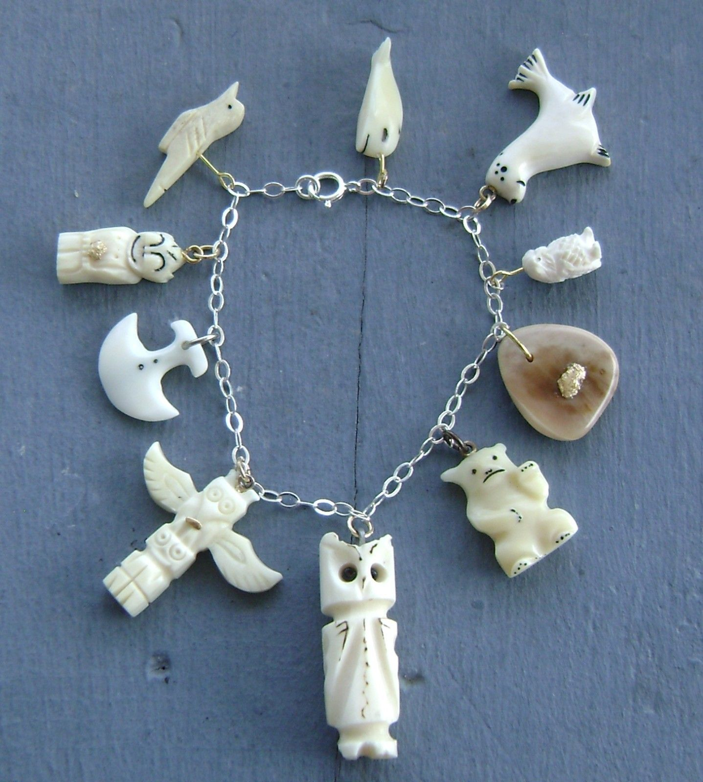 Carved Alaskan ivory and fossil ivory charm bracelet
