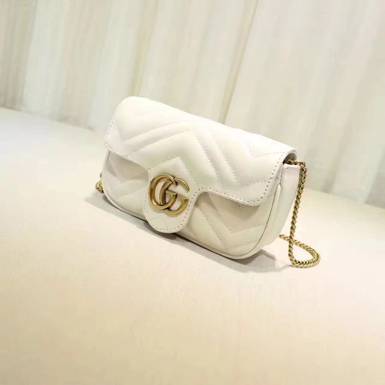 3b472370ecd Replica GUCCI GG Marmont matelasse leather super mini bag white ID 31676