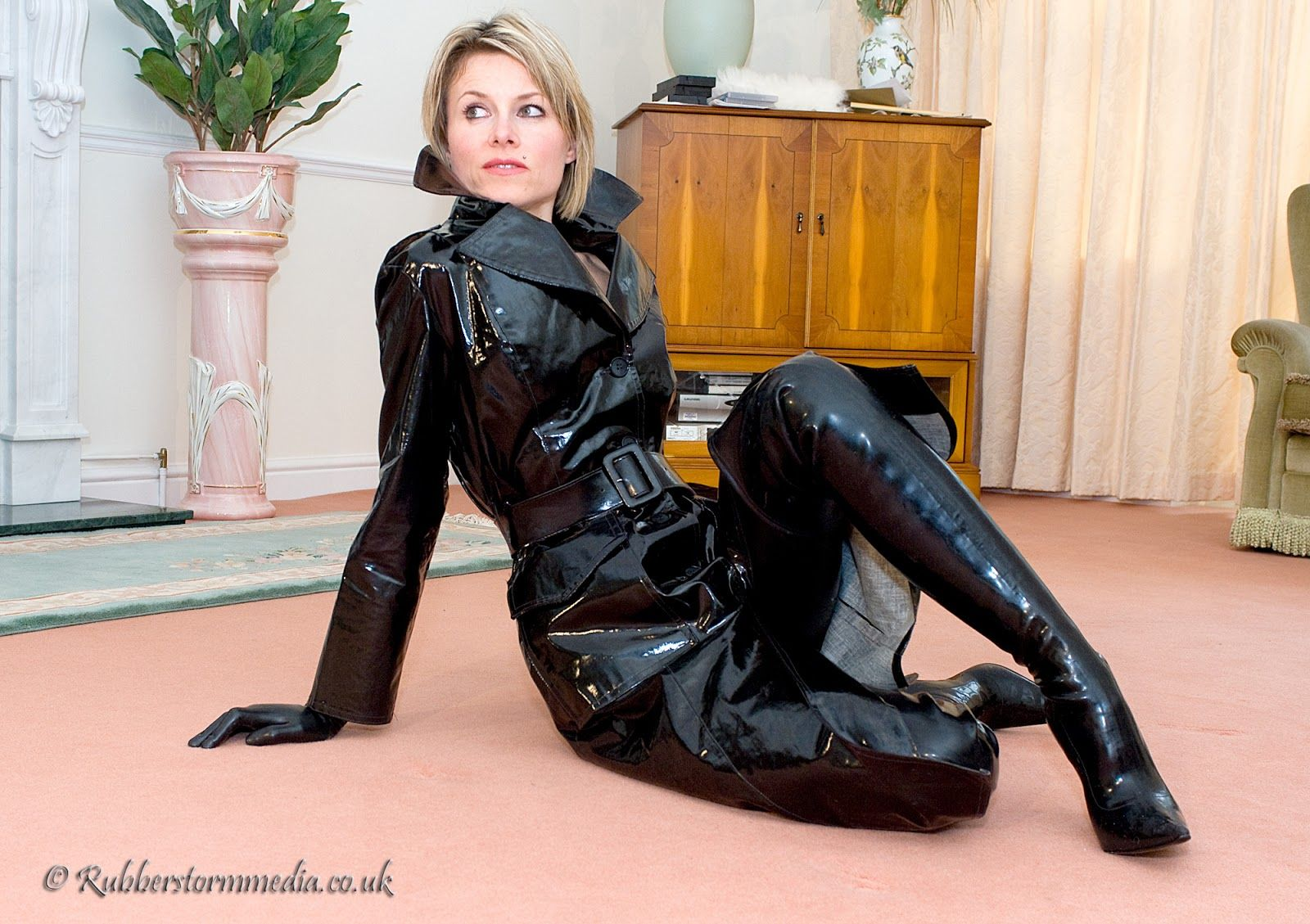 Blonde In Rubber Waders And Trench Coat Indoors Rubber
