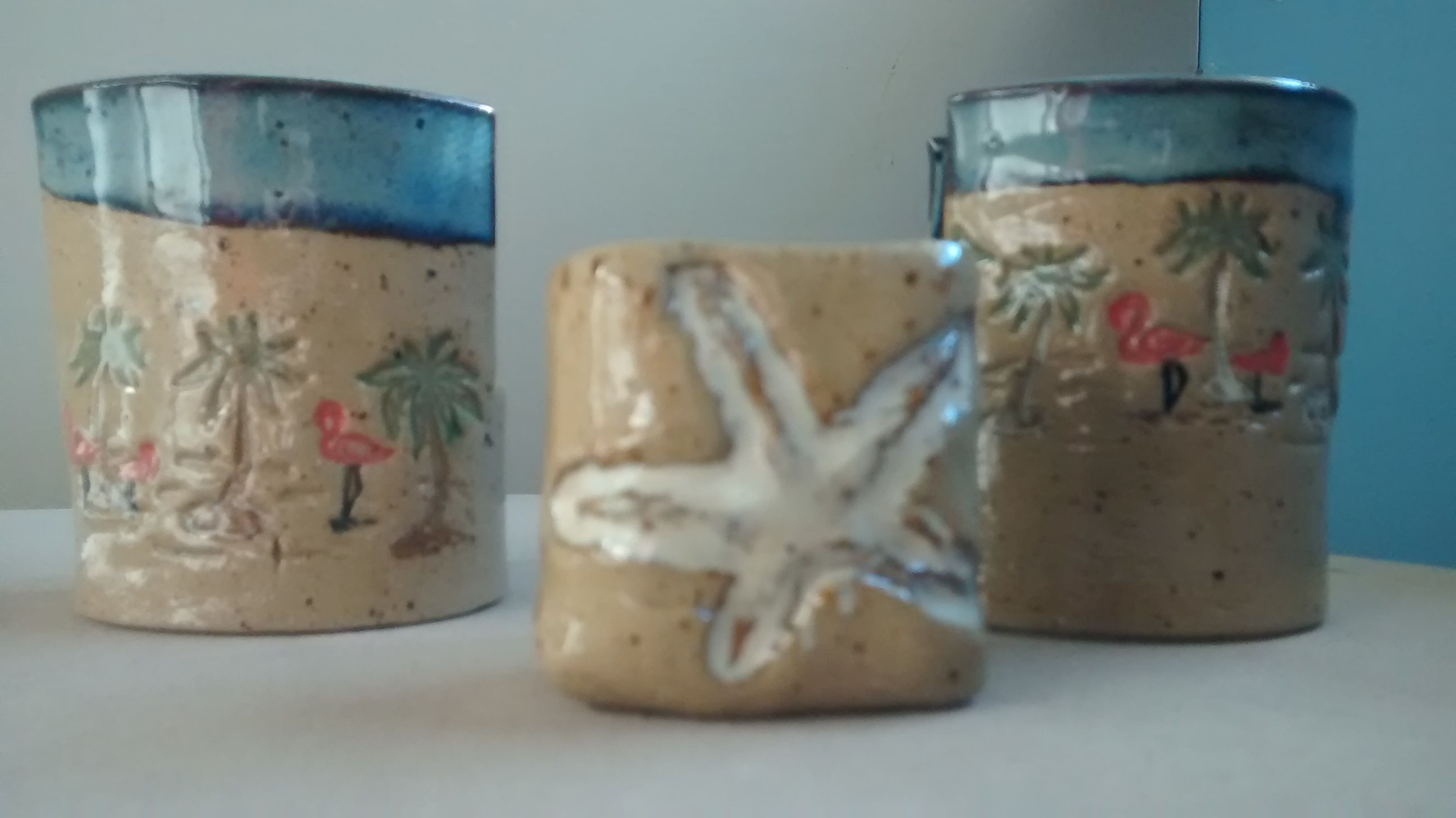 Seashell toothpick holders $7. Large stoneware clay sponge holders $9. each.