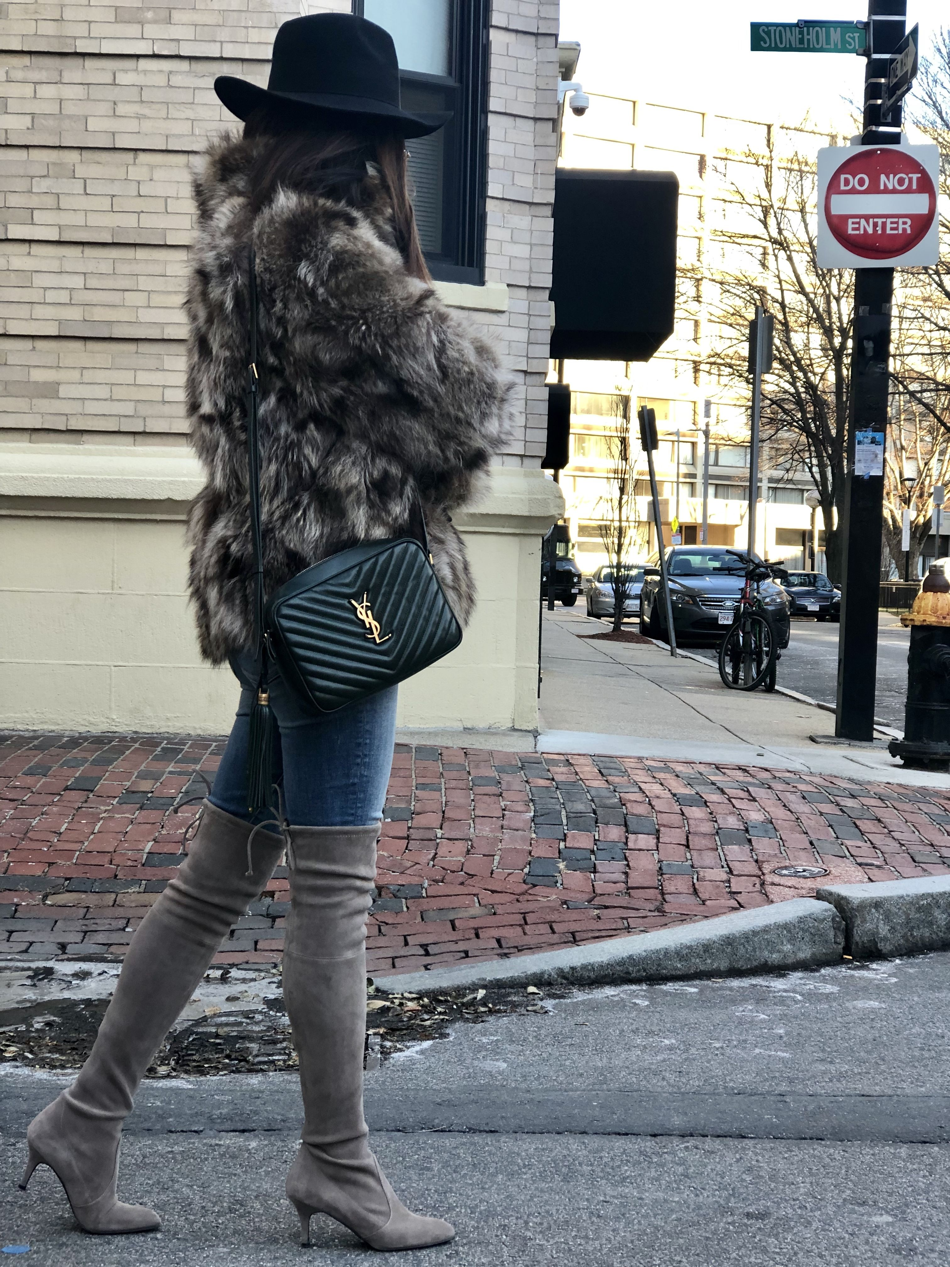 Faux fur coat, ysl camera bag, Stuart weitzman tiemodel over