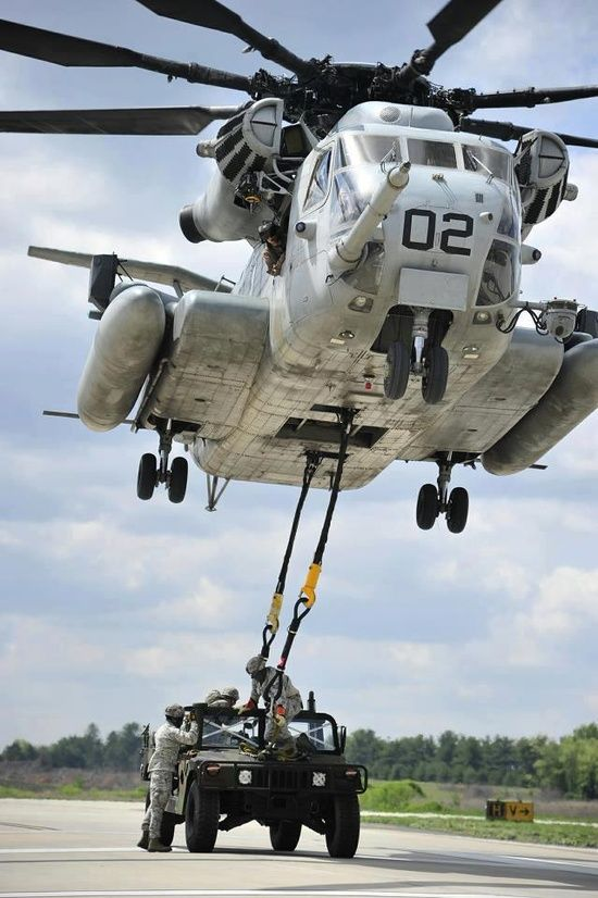 Marine CH-53E Super Stallion slingloading a HMMV.
