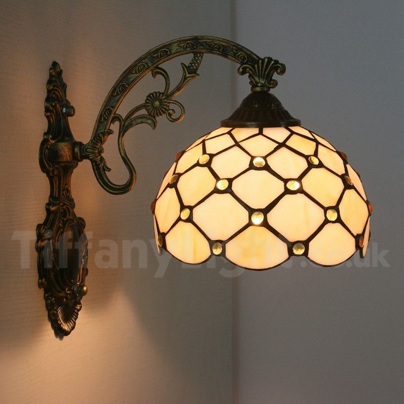 Blue Flower Shade Tiffany Wall Sconce Complemented By Wrought Iron Base Wrought Iron Candle Wall Sconces Iron Wall Lamps Sconces