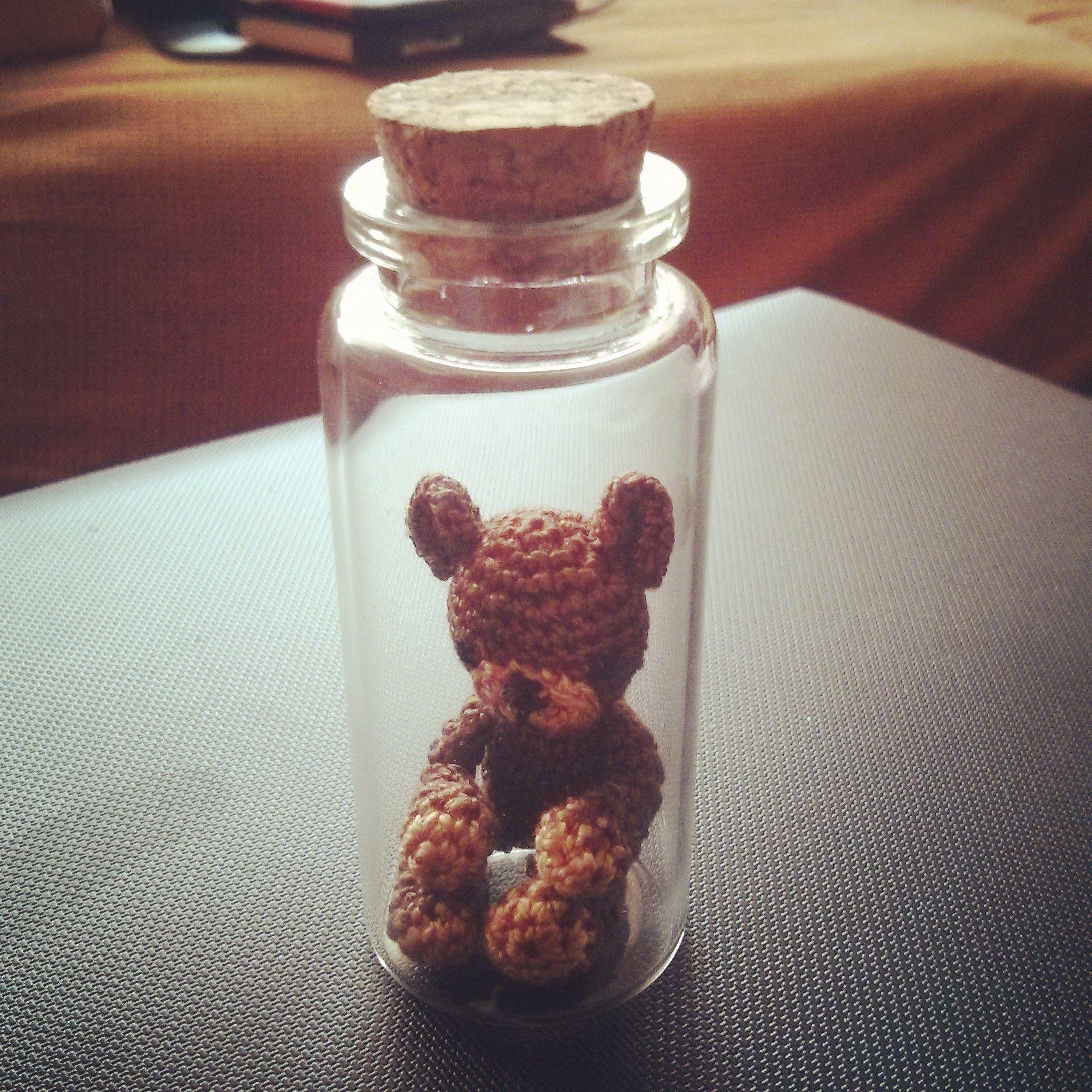 Miniature teddy bear in a bottle
