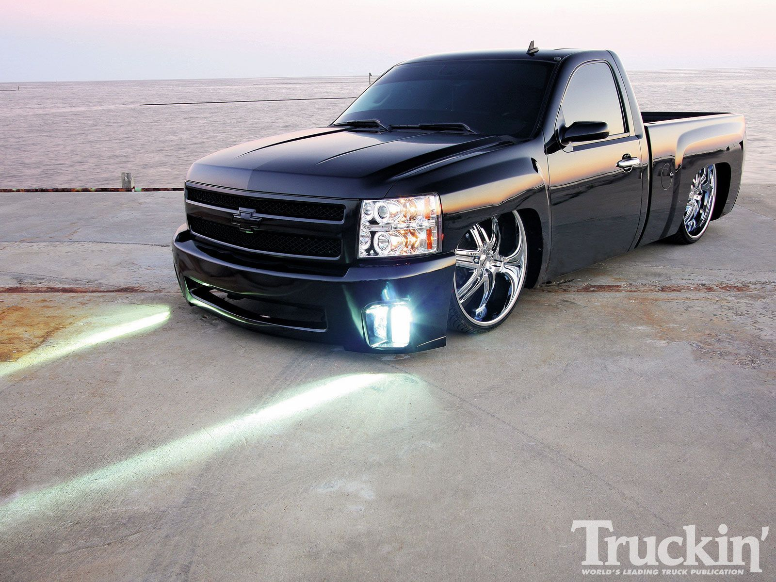 Check out this 2008 chevy silverado with slam specialties re7 airbags halo projector headlights 26 inch rims2008