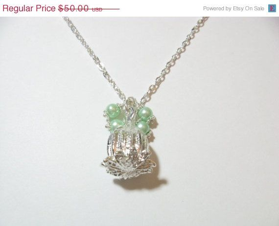 Mint 0.99 sterling silver plated poppy necklace by KrysthleDesigns, $50.00