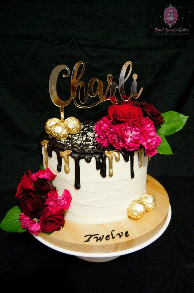 Buttercream Cake With Black Chocolate Drip And Red And Burgundy