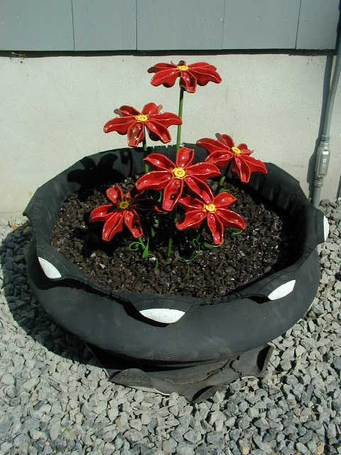 Car parts flowers the planter is an old tire turned for Car tire flower planter