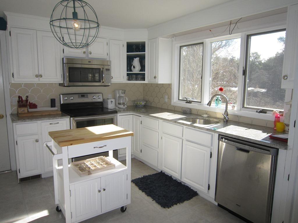 surprising bright sunny kitchen ideas | A bright, sunny Cape Cod kitchen. Love the light fixture ...