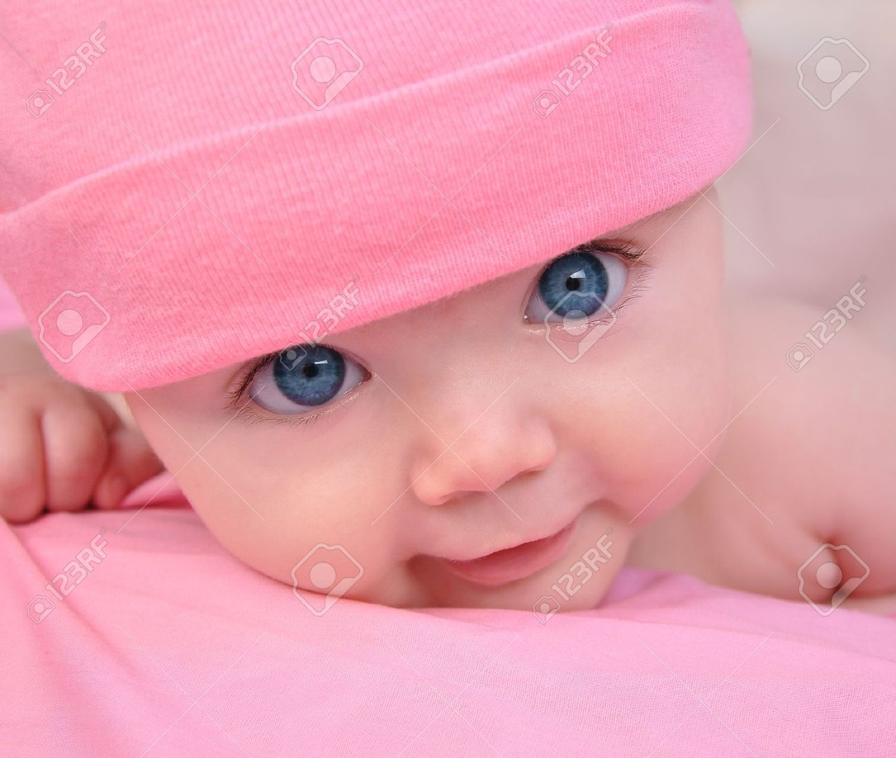 A Cute Little Baby Girl Is Staring Up And Is On A Pink Blanket Blue Eyed Baby Little Baby Girl Cute Little Baby