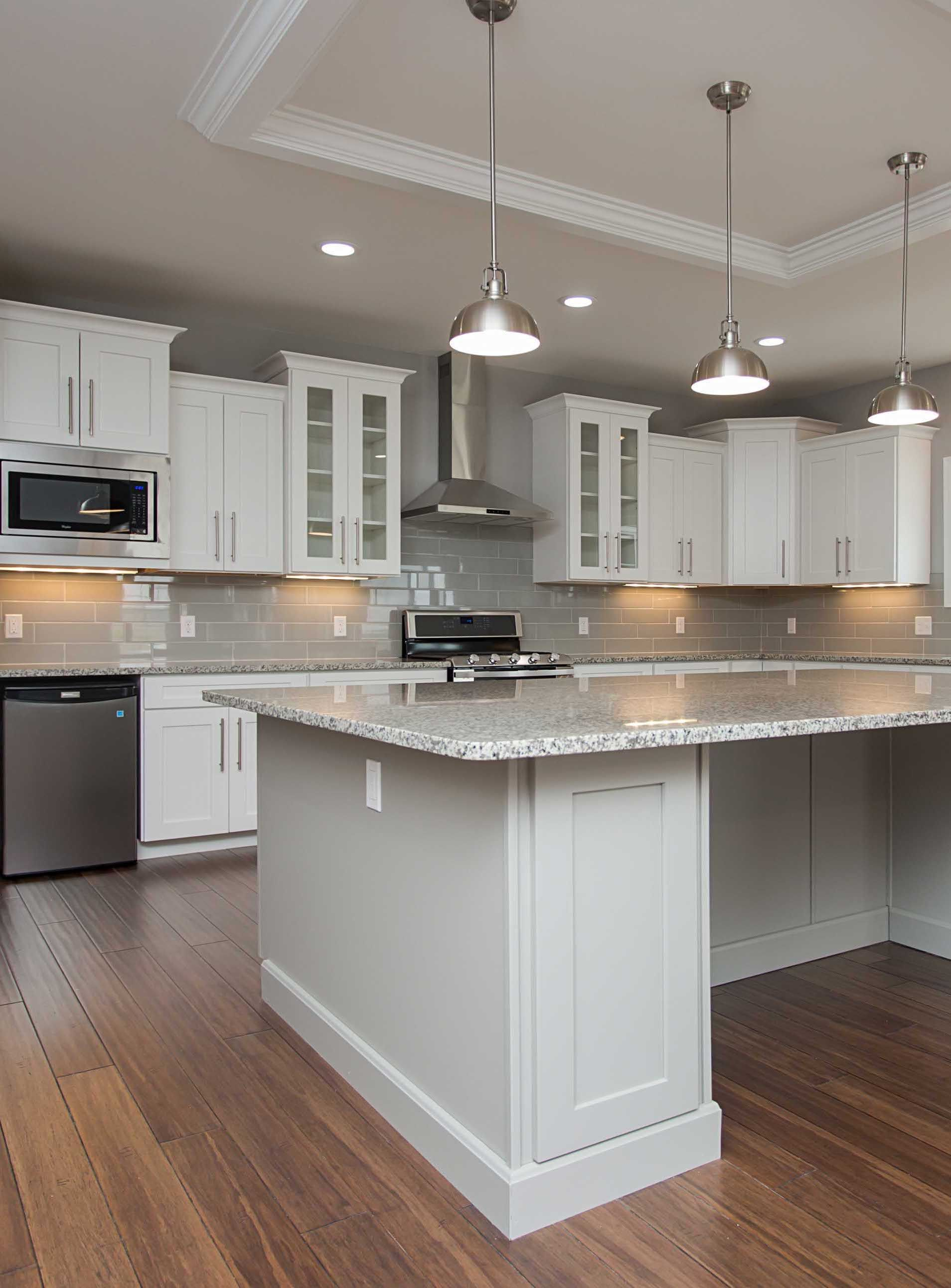 Plenty For The Eye To See In This Stunning Kitchen Two Tone Cabinets Staggere Kitchen Cabinets Height Glass Kitchen Cabinet Doors Staggered Kitchen Cabinets