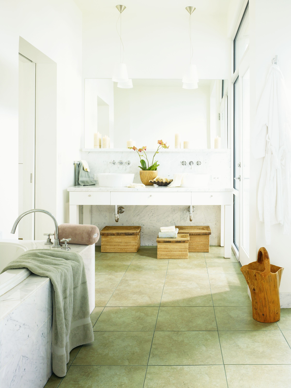 Well lit bathroom with a simple design Vinyl tile