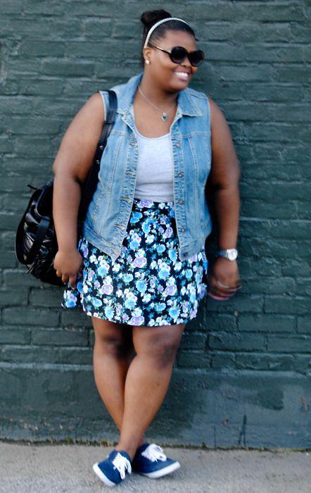 Sunglasses, headband and bun, denim vest, tennis shoes, floral skirt.