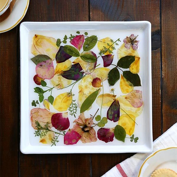 You'll be reminded of your gorgeous wedding bouquet every time you use this custom tray created from the petals of your favorite flowers.