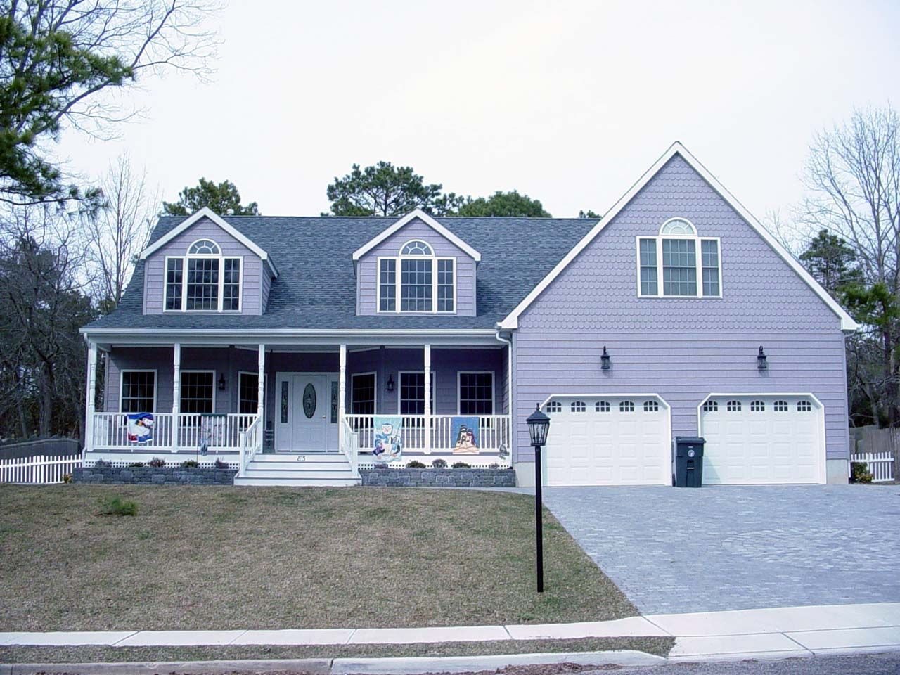 Cape cod style home with farmers porch two car garage and for Garage with dormers