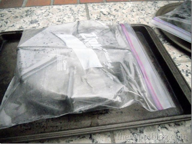 Take the disgusting, yucky burner and seal it up in a big Ziploc-type bag with about 1/4 cup of ammonia and let it sit overnight.