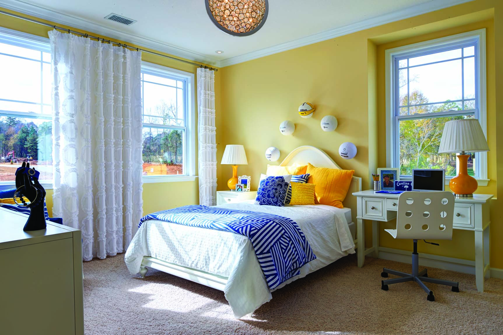 Yellow with a splash of navy adds beautiful brightness to ... on New Model Bedroom Design  id=62992