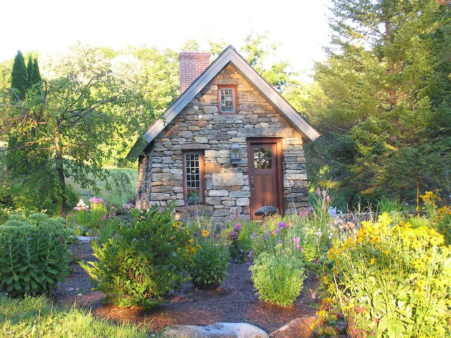 Beautiful home inspired by thoreau s cabin built from for Tiny stone cottage