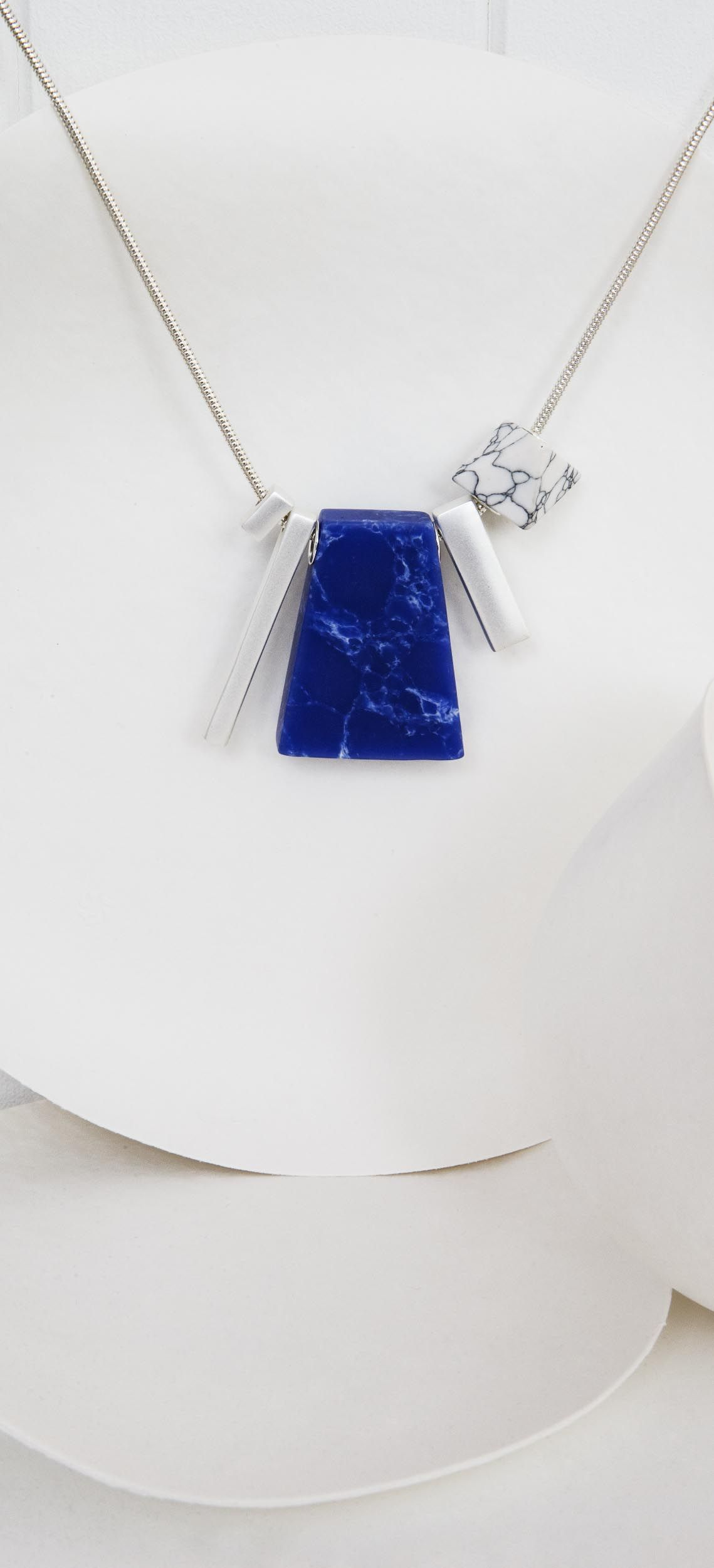 Bold tone and weighty pendants define this claris irregular fan bold tone and weighty pendants define this claris irregular fan necklace aloadofball Image collections