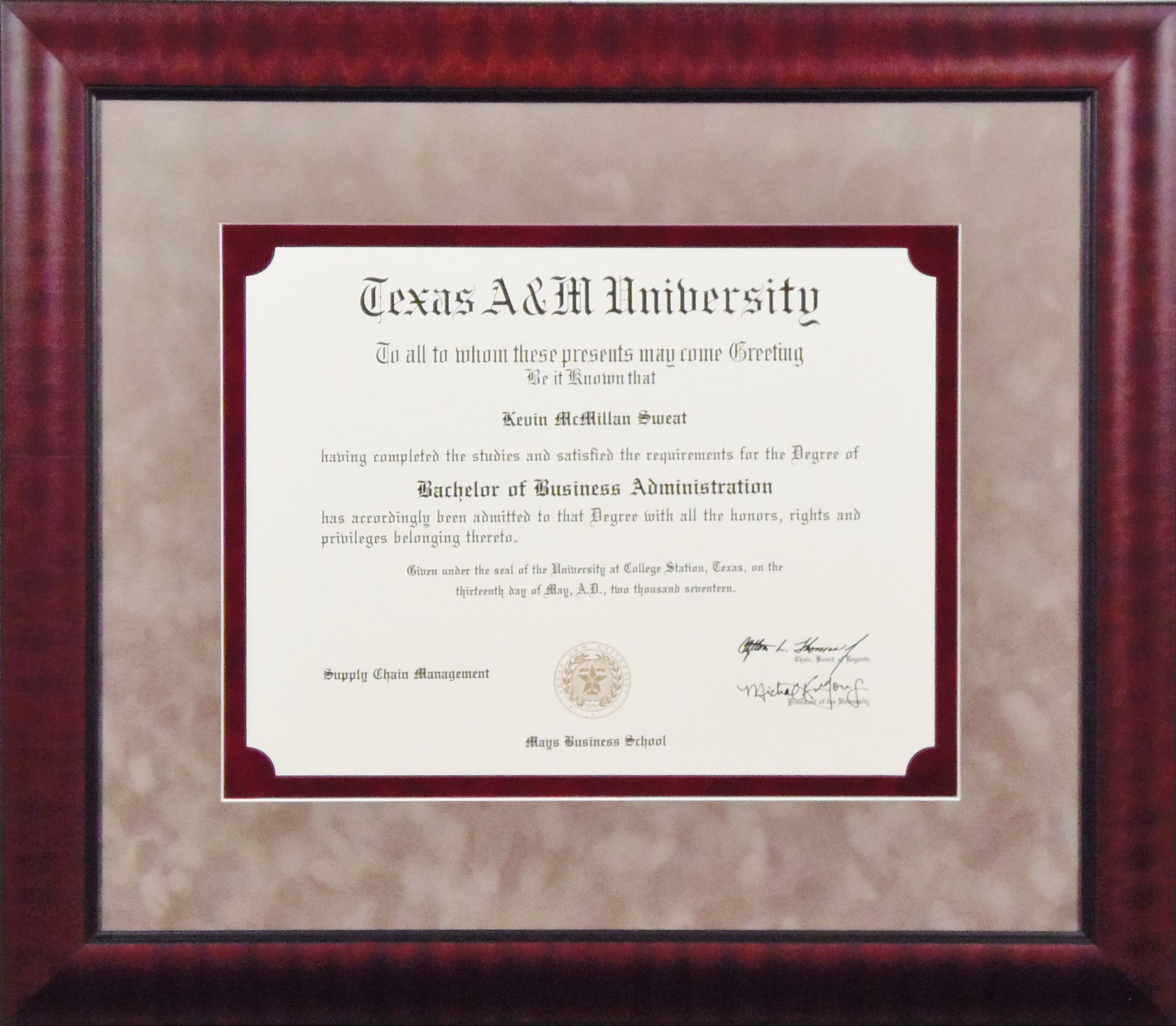 Texas A & M University diploma complimented with two suede mats. The ...