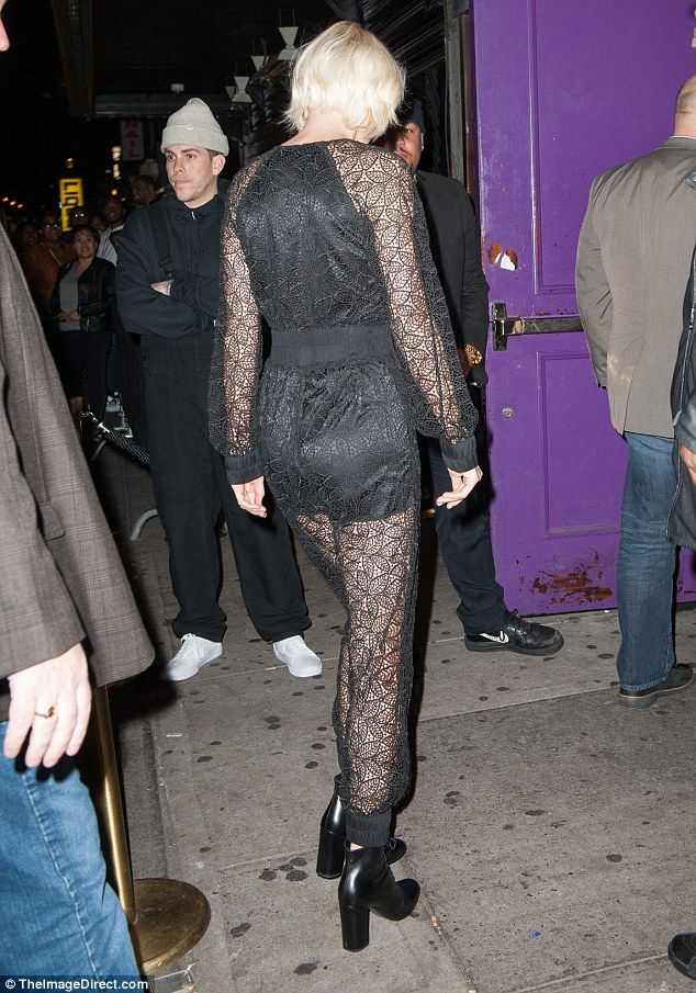 Sheer thing: The 26-year-old's sheer black lace jumpsuit showed off her long legs and tone...