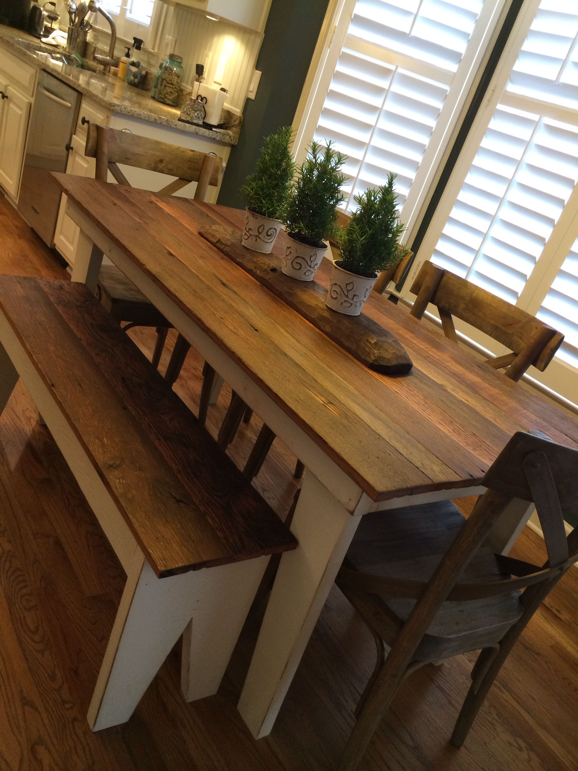 Farmhouse table made with old oak tongue and groove floor boards