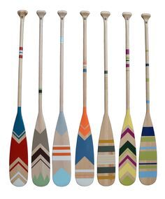 Hand painted canoe paddle collection. Pagaies de canot peintes à la main. Nautical inspiration for your home.