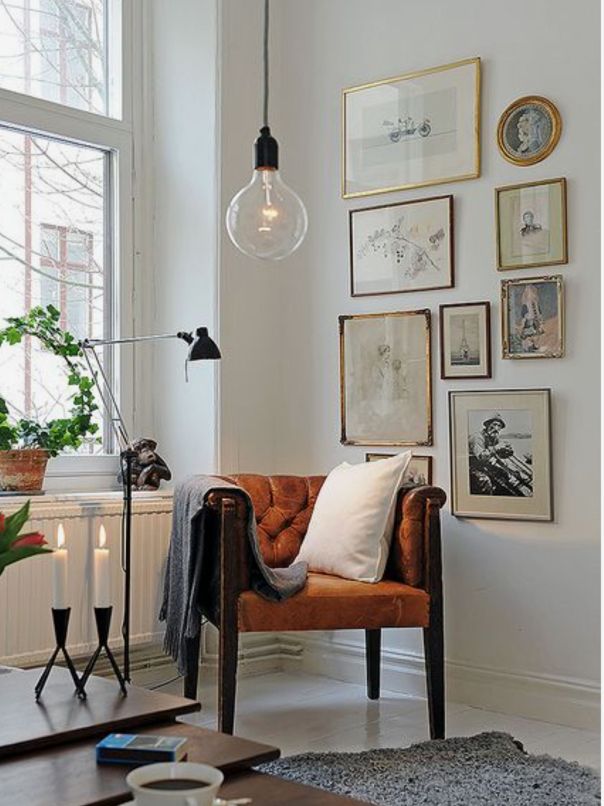 Hanging light over white round table guesthouse greatroom