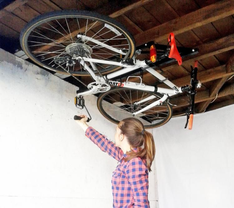 Hide A Ride Lets You Store Your Bicycle On Your Ceiling Bike Storage Apartment Bicycle Bike Rack Garage