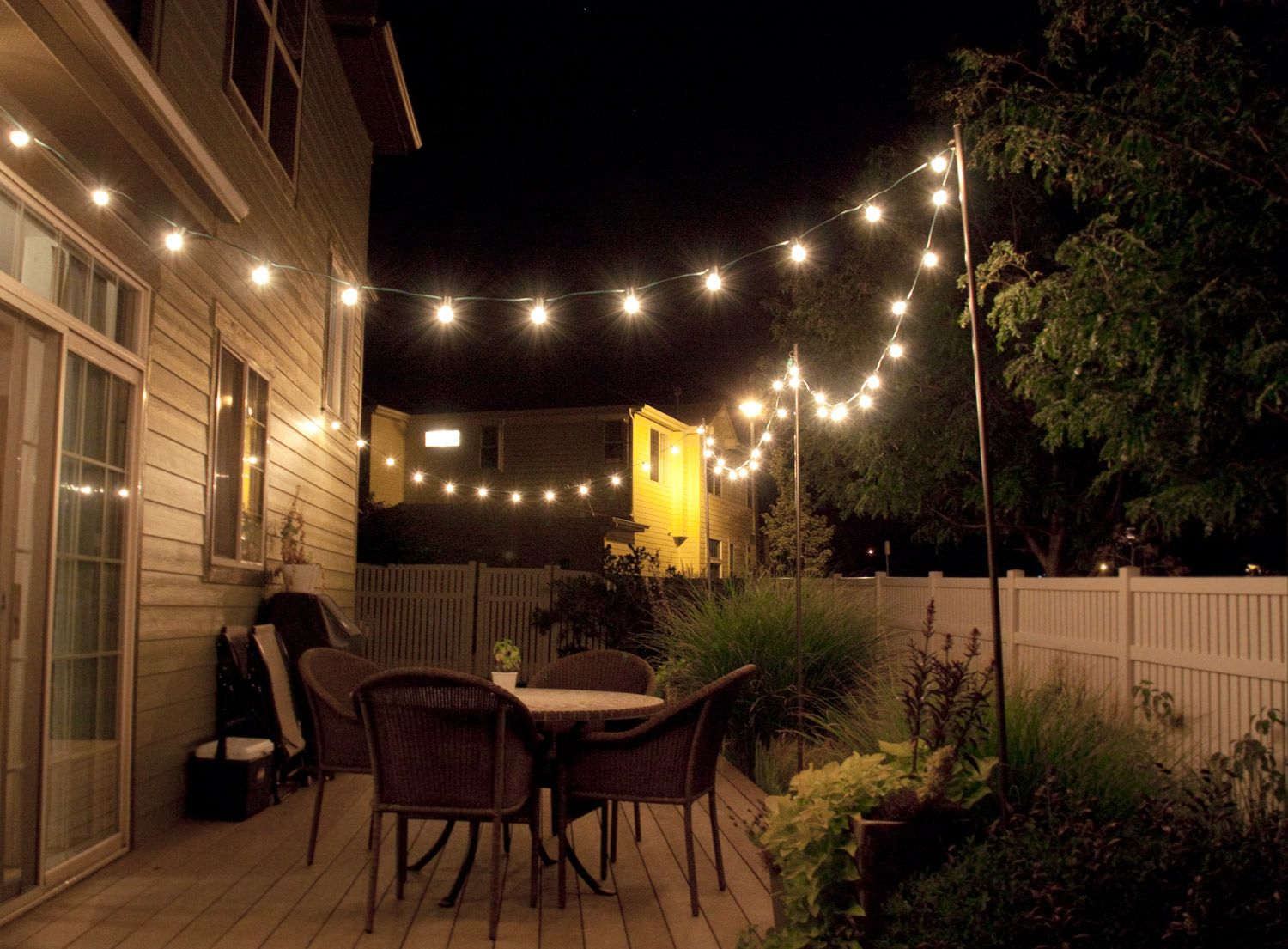 How to make inexpensive poles to hang string lights on - café style! Via Bright July : outdoor lights patio - www.canuckmediamonitor.org